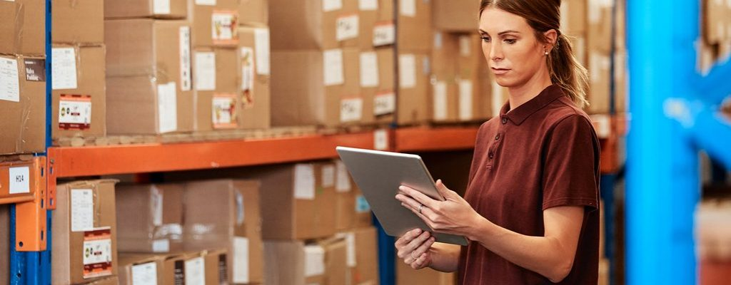 Shot of a young woman using a digital tablet in a warehouse